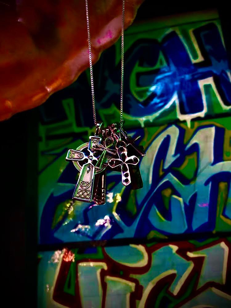 Multiple metal crosses on a jewlery chain