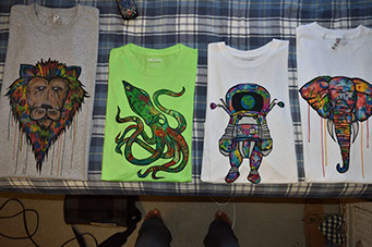 tee shirts with colorful animal and astronaut designs