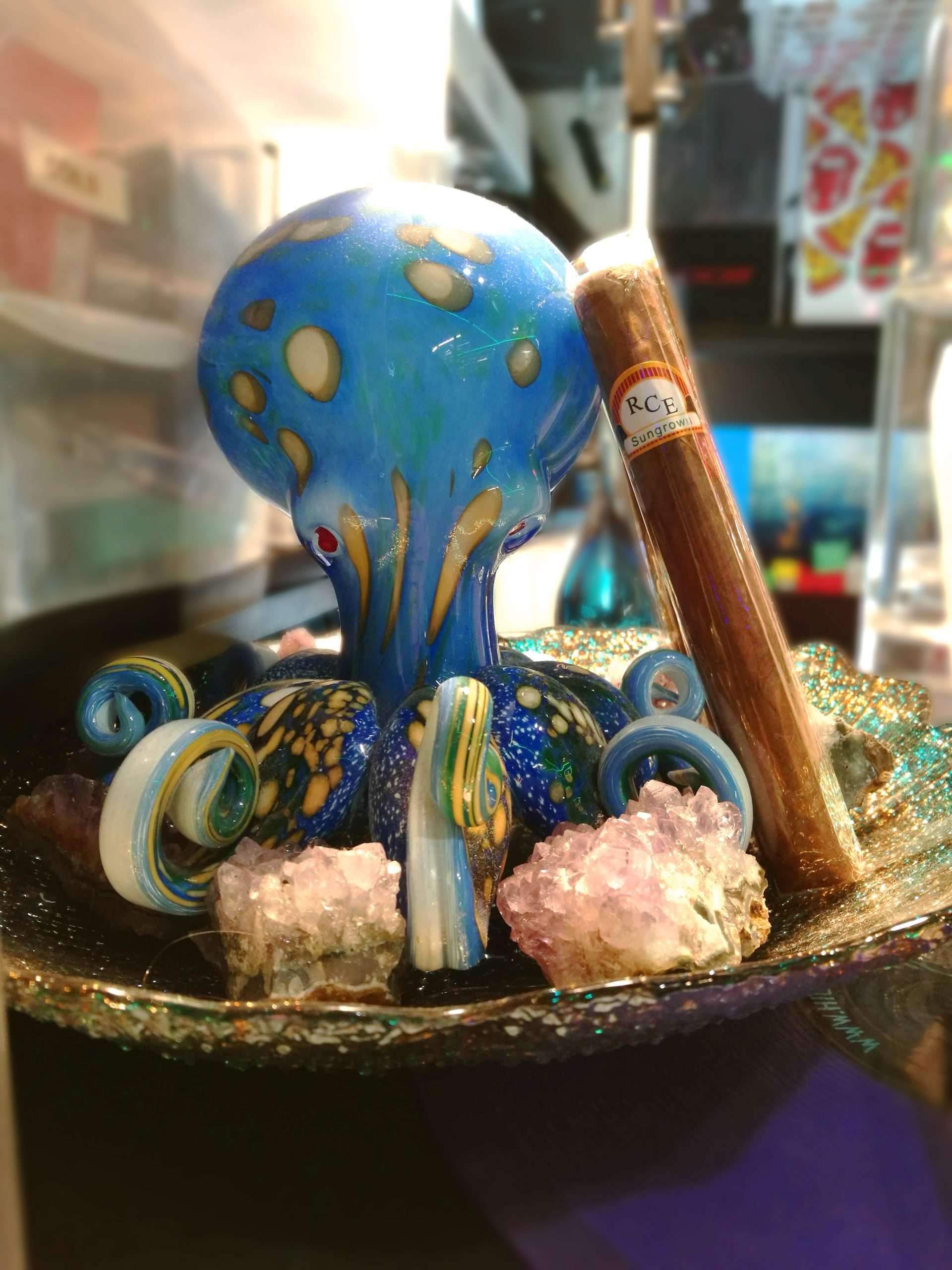 RCE cigar leaning on a glass octopus